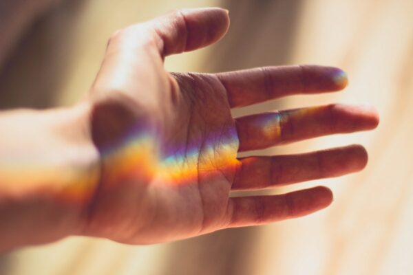 hand with rainbow lighting