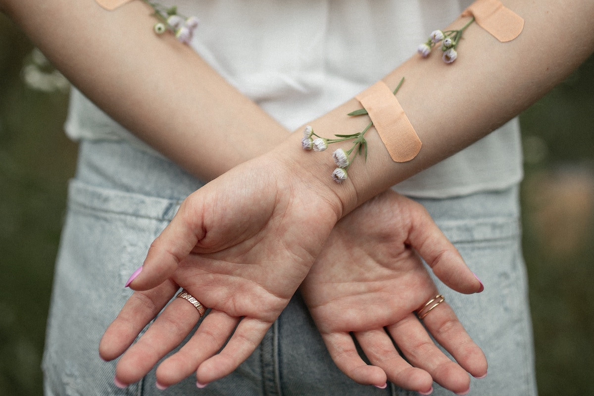arms with flowers on them