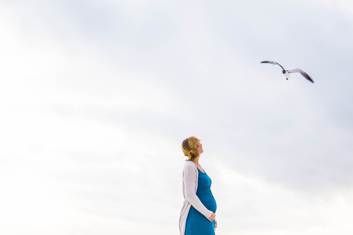 woman standing with bird