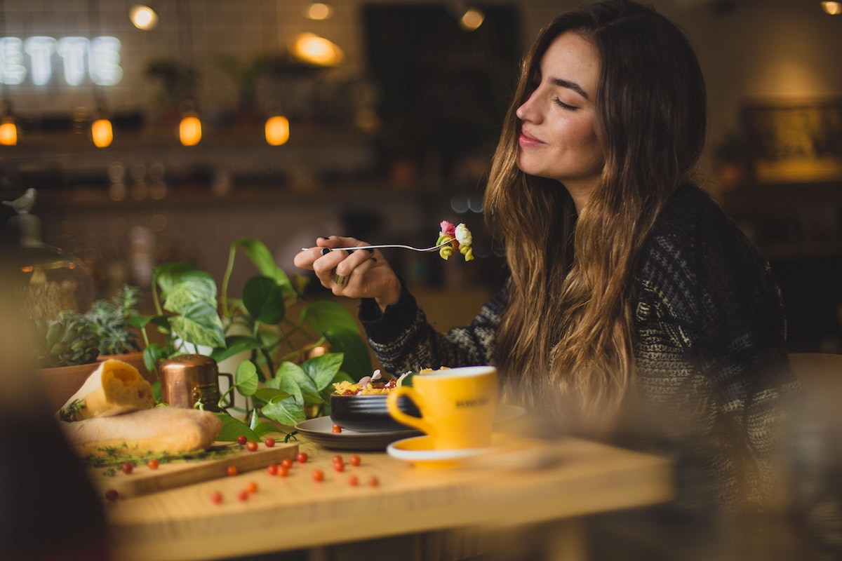 woman eating at table