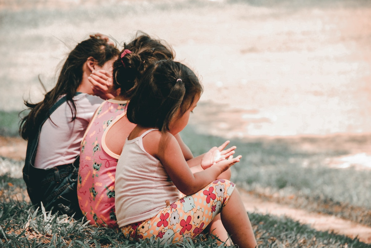 young girls sitting together