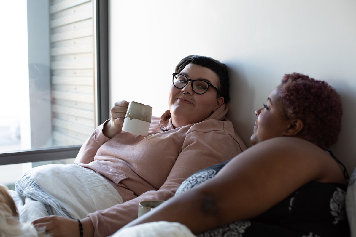 Women in bed together